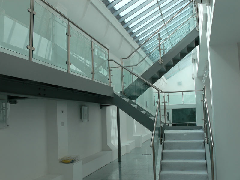 Lovely A Steel Staircase With Stainless Steel Handrails And Pan Treads Filled With  Concrete.